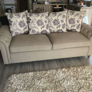 For sale: 2x Settee one is bed settee both as new .Champagne and floral cushions . - £150