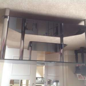 For sale: Black glass corner TV Stand with chrome legs