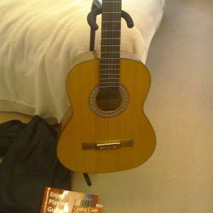 For sale: 3/4 guitar, case stand and books - £25