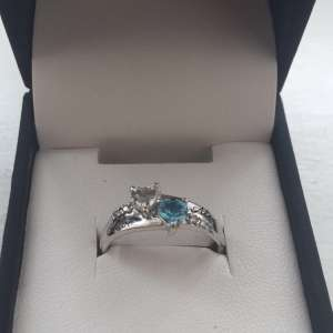 Lost: White and blue white gold engagement ring. Engravings of names on it. Lost at grass ditch near pasture avenue