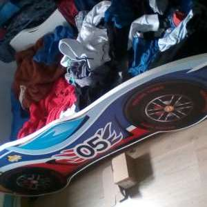 For sale: Children's wooden racing car bed - £30