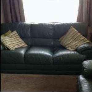 For sale: Two three seater leather sofas