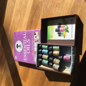 For sale: Unused 9 aromatherapy oils and book - £30
