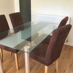 For sale: Glass dining table and 4 chairs