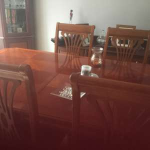 For sale: Large dining table and six chairs including 2 carvers