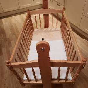 For sale: Swinging crib