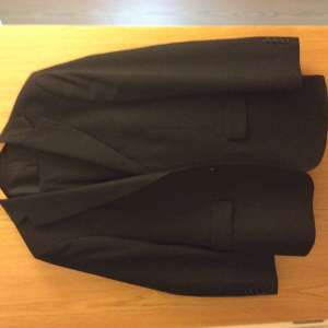 For sale: Men's M&S black dress suit size medium (jacket 40in, trousers 30/31)