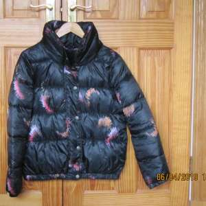 For sale: M & Co ladies black patterned puffa jacket. Size 14. Immaculate.